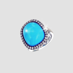 turquoise cabochon and diamond cluster ring set